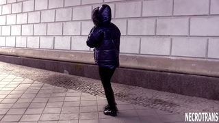 Girl in leather suit, silver blue downjacket with faux fur on hood + black gas mask with two filters