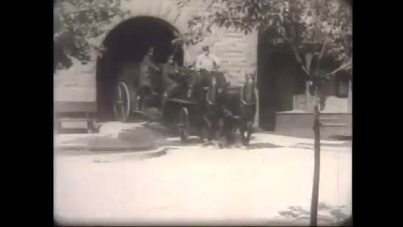 Escanaba Michigan Fire Department with Horse Drawn Wagons on Ludington St. 1920
