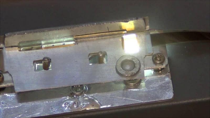 Самодельный грейферный механизм с фильмовым каналом для оцифровки 8 мм кинопленок