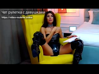 Sexy bimbo girl in pvc dress and boots