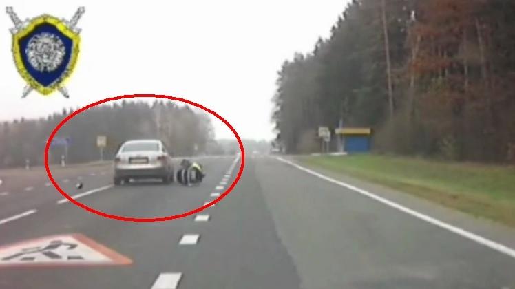 """Водитель AUDI """"прокатил"""" на капоте сотрудника ГАИ и скрылся с места происшествия"""