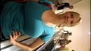 Stephanie torquoise shirt riding escalator